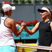 Ash Barty (L) and Daria Gavrilova at net after Barty won their first-round match in Madrid (Getty Images)