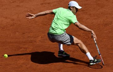 Australia's John Millman returns the ball to Germany's Alexander Zverev during their men's singles first round match on day three of The Roland Garros 2019 French Open tennis tournament in Paris on May 28, 2019. (Photo by Philippe LOPEZ / AFP)        (Photo credit should read PHILIPPE LOPEZ/AFP/Getty Images)