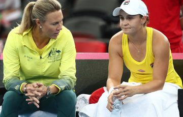 BRISBANE, AUSTRALIA - APRIL 21: Ashleigh Barty and Australian Captain Alicia Molik talk in her match against Aryna Sabalenka of Belarus during the Fed Cup World Group Semi Final - Australia v Belarus at Pat Rafter Arena on April 21, 2019 in Brisbane, Australia. (Photo by Chris Hyde/Getty Images)