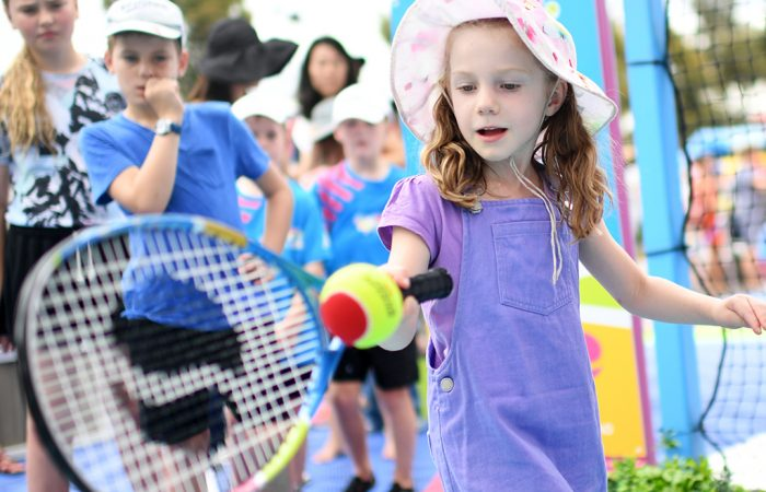 MELBOURNE, AUSTRALIA - JANUARY 17:  A young fan plays tennis at AO Ballpark Hot Shots during day four of the 2019 Australian Open at Melbourne Park on January 17, 2019 in Melbourne, Australia.  (Photo by Tracey Nearmy/Getty Images For Tennis Australia)