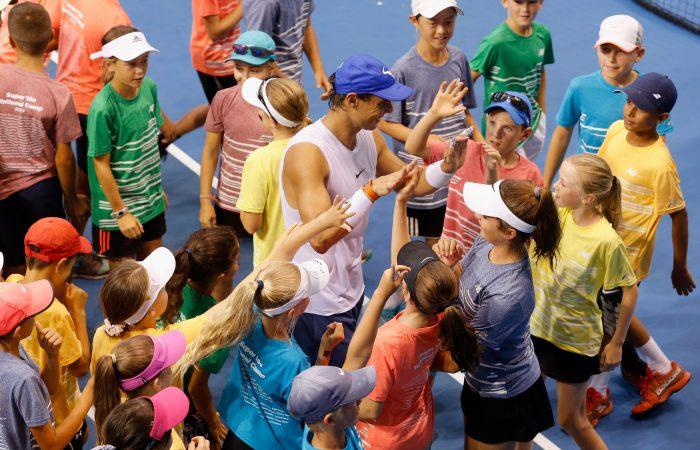 MELBOURNE, AUSTRALIA - JANUARY 25:  Rafael Nadal photo opp with kids at the National Tennis Centre during day 13 of the 2019 Australian Open at Melbourne Park on January 24, 2019 in Melbourne, Australia.  (Photo by Wayne Taylor/Getty Images For Tennis Australia)
