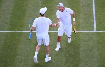 FIRED UP: Lleyton Hewitt and Jordan Thompson during their first-round win at Wimbledon; Getty Images