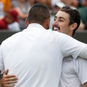 Nick Kyrgios (L) and Jordan Thompson embrace following their first-round match at Wimbledon (Getty Images)