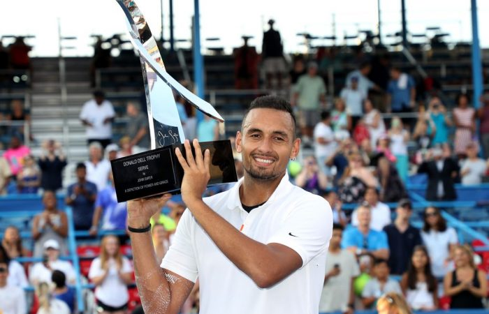 Nick Kyrgios hoists his trophy after winning the ATP title in Washington DC (Getty Images)