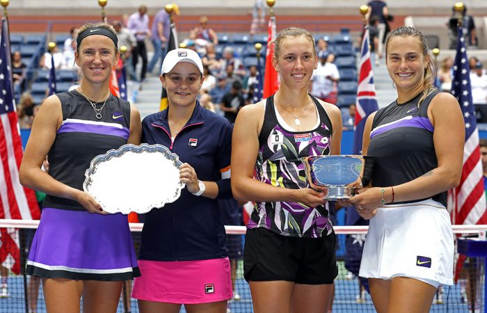 Ash Barty and Victoria Azarenka pose with their runners-up trophy next to US Open women's doubles champions Elise Mertens and Aryna Sabalenka (Getty Images)