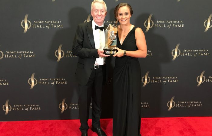 Ash Barty (R) poses with The Don award alongside Tennis Australia CEO Craig Tiley in Melbourne.