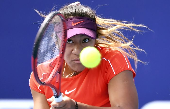 TOPSHOT - Destanee Aiava of Australia hits a backhand return to Sorana Cirstea of Romania on the final day of the Kooyong Classic tennis tournament in Melbourne January 10, 2019. (Photo by William WEST / AFP) / -- IMAGE RESTRICTED TO EDITORIAL USE - STRICTLY NO COMMERCIAL USE --        (Photo credit should read WILLIAM WEST/AFP/Getty Images)