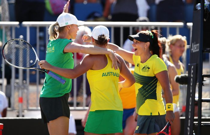TEAM SPIRIT: Alicia Molik, Ash Barty and Casey Dellacqua celebrate during a Fed Cup in Canberra in February 2018. Picture: Getty Images