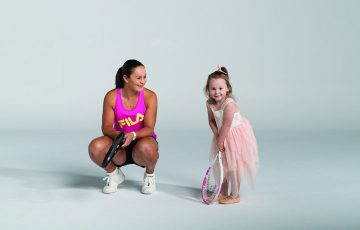 INSPIRATION: World No.1 Ash Barty, pictured with her niece Lucy, is proving a positive role model for females. Picture: Tennis Australia