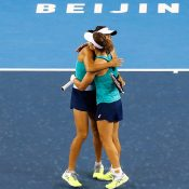 Sam Stosur (R) and Zhang Shuai in action at the WTA China Open in Beijing (Getty Images)