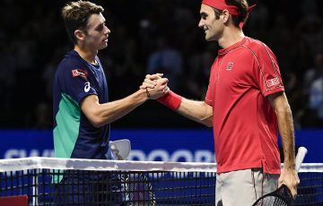 Swiss Roger Federer (R) shakes hands to Australian Alex De Minaur after winning at the Swiss Indoors tennis tournament in Basel on October 27, 2019. (Photo by FABRICE COFFRINI / AFP) (Photo by FABRICE COFFRINI/AFP via Getty Images)