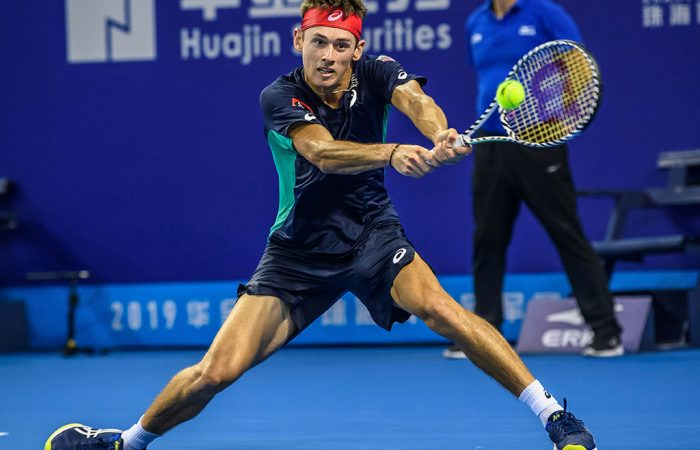 Alex de Minaur of Australia hits a return against Adrian Mannarino of France during their men's singles final match at the Zhuhai Championships tennis tournament in Zhuhai in China's southern Guangdong province on September 29, 2019. (Photo by STR / AFP) / China OUT        (Photo credit should read STR/AFP/Getty Images)