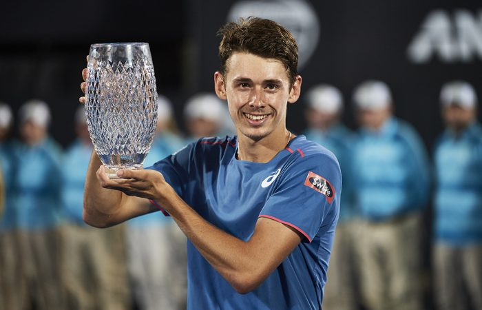 Alex de Minaur hoists the trophy after winning the Sydney International ATP title. (Getty Images)