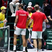 Canada's Vasek Pospisil (L) and Denis Shapovalov shake hands with Australia's John Peers (L) and Jordan Thompson after winning the decisive doubles rubber in the quarterfinals in Madrid. (Getty Images)