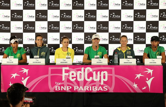 The Australian Fed Cup team of (L-R) Priscilla Hon, Ajla Tomljanovic, Ash Barty, Alicia Molik, Sam Stosur and Astra Sharma speak to the press ahead of the 2019 final against France in Perth. (Getty Images)