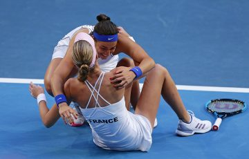 Caroline Garcia embraces Kristina Mladenovic (sitting) after the duo beat Ash Barty and Sam Stosur in the fifth rubber to win the Fed Cup title for France. (Getty Images)