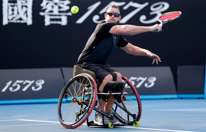 MELBOURNE, AUSTRALIA - JANUARY 25:  Ben Weekes of Australia plays a backhand in his Men's Wheelchair Doubles Final with Stephane Houdet of France against Joachim Gerard of Belgium and Stefan Olsson of Sweden during day 12 of the 2019 Australian Open at Melbourne Park on January 25, 2019 in Melbourne, Australia.  (Photo by Darrian Traynor/Getty Images)
