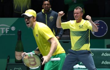 PUMPED: John Peers, Nick Kyrgios and captain Lleyton Hewitt celebrate Australia's 3-0 win over Colombia in their opening group match in Madrid; Getty Images