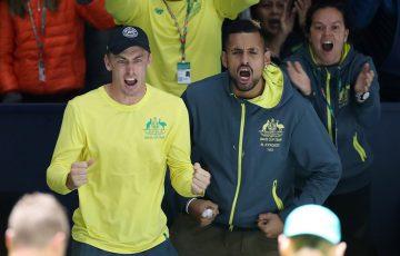 John Millman (L) and Nick Kyrgios cheer on Alex de Minaur during Australia's Davis Cup tie against Belgium in Madrid. (Getty Images)