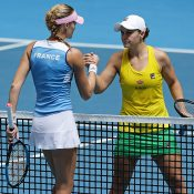 Kristina Mladenovic (L) shakes hands with Ash Barty after winning the first of the reverse singles rubbers in the 2019 Fed Cup final in Perth. (Getty Images)