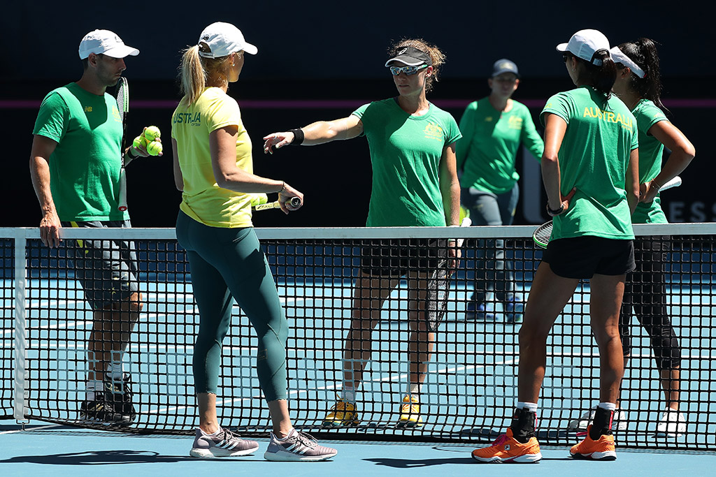 Sam Stosur (centre) chats to the Australian Fed Cup team during a doubles training session ahead of the final in Perth. (Getty Images)