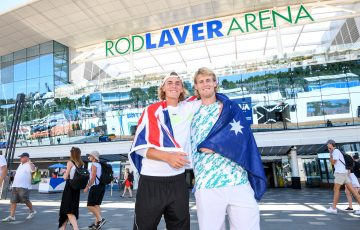 Max Purcell of Australia poses with doubles partner Luke Saville (R) in front of Rod Laver Arena during day ten of the Australian Open tennis tournament in Melbourne, Wednesday, January 29, 2020. (AAP Image/Vince Caligiuri) NO ARCHIVING, EDITORIAL USE ONLY