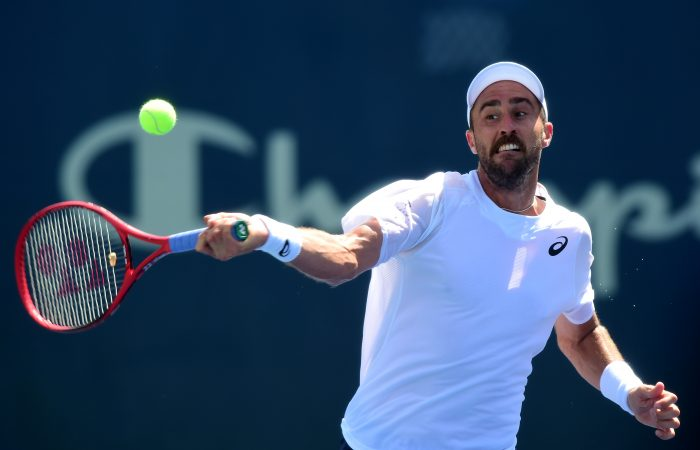 WINSTON SALEM, NORTH CAROLINA - AUGUST 23: Steve Johnson returns a shot from John Millman of Australia during their quarterfinals match on day seven of the Winston-Salem Open at Wake Forest University on August 23, 2019 in Winston Salem, North Carolina. (Photo by Jared C. Tilton/Getty Images)