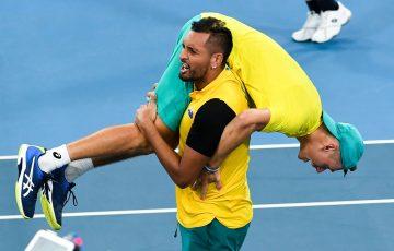 Nick Kyrgios and Alex de Minaur celebrate Team Australia's epic quarterfinal victory at the ATP Cup in Brisbane; Getty Images