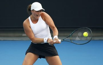 MELBOURNE, AUSTRALIA - JANUARY 14: Ivana Popovic of Australia plays a backhand in her match against Ana Bogdan of Romania during 2020 Australian Open Qualifying at Melbourne Park on January 14, 2020 in Melbourne, Australia. (Photo by Daniel Pockett/Getty Images)