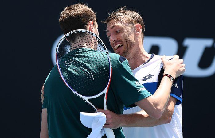 John Millman (R) congratulates Ugo Humbert after winning their Australian Open first-round match. (Getty Images)