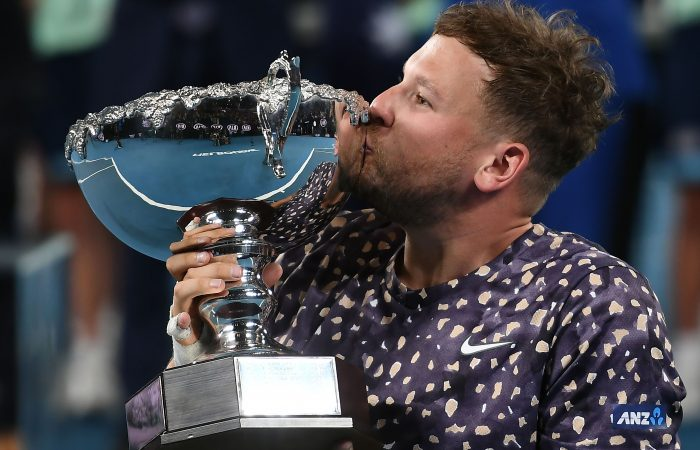 SIX IS SWEET: Australia's Dylan Alcott kisses his Australian Open trophy. Picture: Getty Images