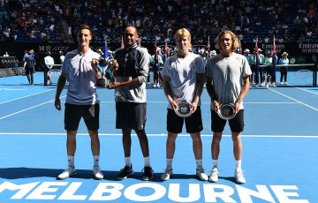 Max Purcell (far right) and Luke Saville (next to Purcell) pose with their Australian Open men's doubles finalists trophies (photo: Getty Images)