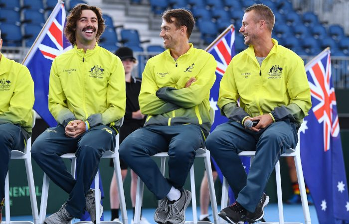 HAPPY TEAM: Jordan Thompson, John Millman and Lleyton Hewitt share a laugh during the official draw ceremony for the Davis Cup qualifying tie against Brazil in Adelaide. Picture: Getty Images