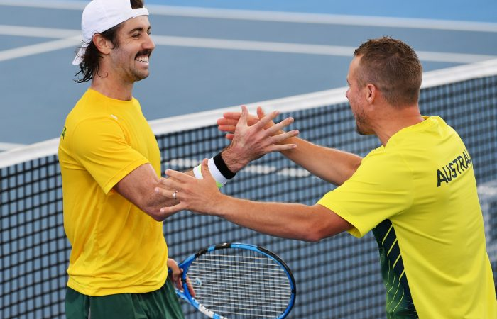 FIRED UP: Jordan Thompson celebrates his Davis Cup victory against Brazil's Thiago Monteiro with Aussie captain Lleyton Hewitt. Picture: Getty Images