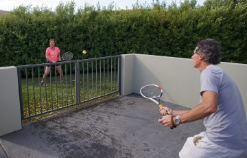 PLAYING AT HOME: A backyard can become a tennis court. Picture: David Dickson Photography