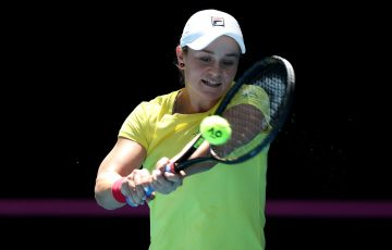 SMILES ALL ROUND: Ash Barty on the practice court. Picture: Getty Images
