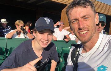HAPPY FAN: Connor Joyce with his favourite player John Millman at Wimbledon 2019.