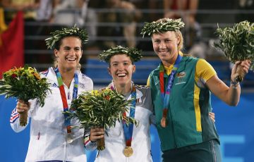 HONOUR: Amelie Mauresmo of France, Justine Henin of Belgium and Australia's Alicia Molik receive their medals at the 2004 Olympic Games in Athens. Picture: Getty Images