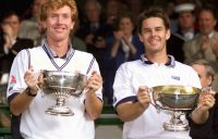 CHAMPIONS: Mark Woodforde and Todd Woodbridge celebrate winning their sixth Wimbledon gentlemen's doubles title in 2000. Picture: Getty Images