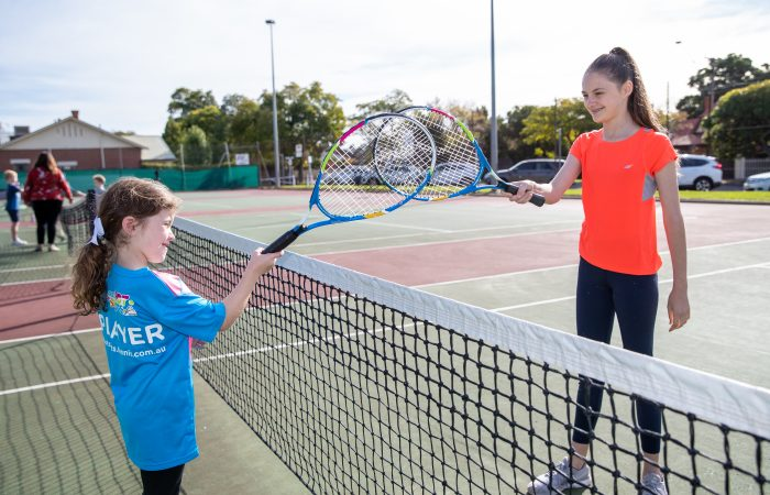 FUN ON COURT: South Australian players are embracing physical distancing measures to keep playing tennis.