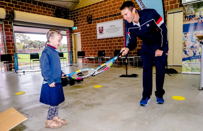 MAKING A RACQUET: Doubles champion John Peers gifts a new tennis racquet to a first year primary school student in Perth. Picture: Tennis Australia
