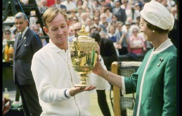 Rod Laver accepts the winner's trophy from Queen Elizabeth at 1968 Wimbledon; Getty Images