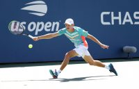 FIGHTING SPIRIT: Alex de Minaur stretches for a forehand during his third round win at the US Open. Picture: Getty Images