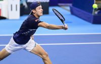 MOVING ON: Alex de Minaur stretches for a volley in Antwerp. Picture: Getty Images