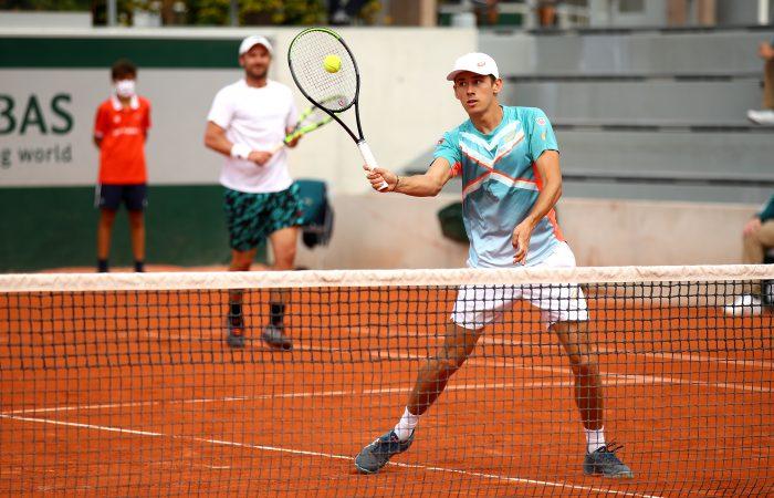 MATES: Alex de Minaur and Matt Reid during their first-round win at Roland Garros. Picture: Getty Images