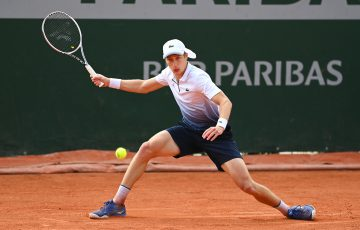 FOCUSED: Marc Polmans slides to a forehand during his second round match at Roland Garros. Picture: Getty Images