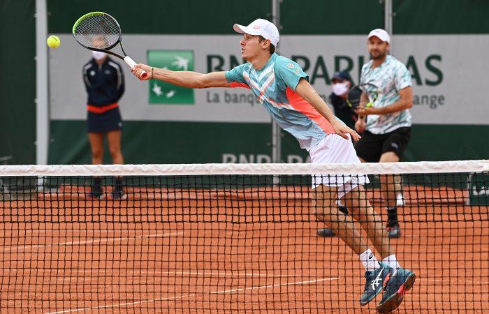 STRETCHED: Alex de Minaur and Matt Reid lost their second round doubles match at Roland Garros. Picture: Getty Images