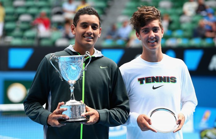 TOP JUNIORS: Nick Kyrgios and Thanasi Kokkinakis with their trophies after the Australian Open 2013 boys' singles final. Picture: Getty Images