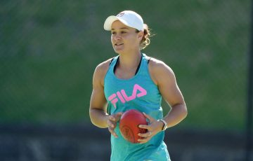 HAVING FUN: Ash Barty warm-ups for a practice session. Picture: Scott Barbour, Tennis Australia