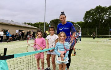 Casey Dellacqua with Cobargo community members during a Rally as one event in New South Wales.